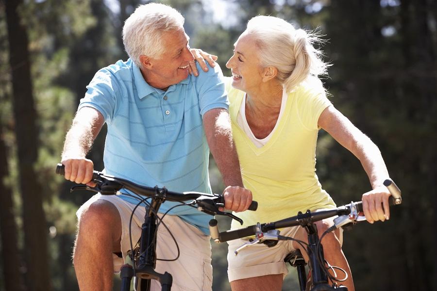 Two happy seniors riding bikes